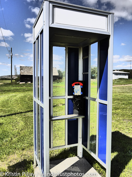 Phone booth in a field in ghost town Dorothy, AB